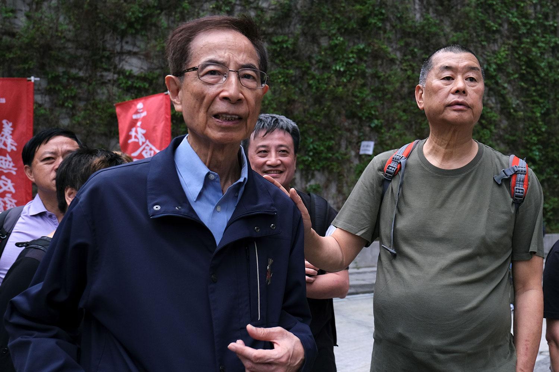 2019年3月31日,民主党创党主席李柱铭(左)和壹传媒创办人黎智英(右)在香港反《逃犯条例》活动中。(路透社)