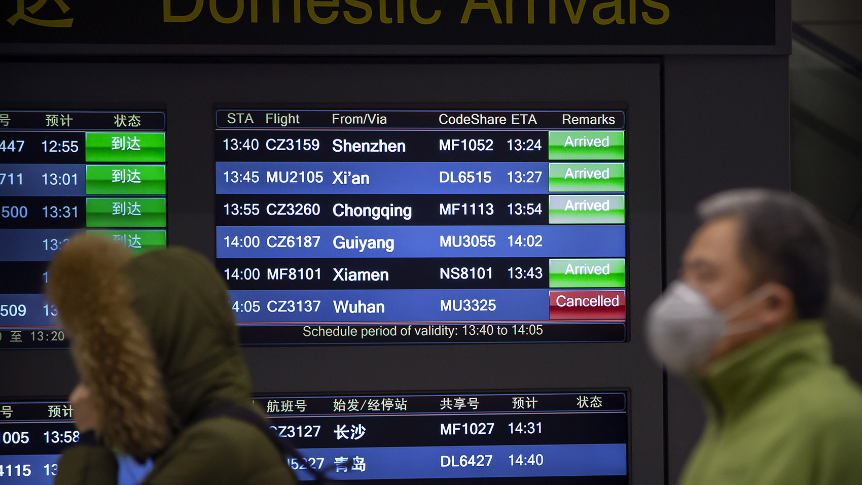 Beijing airport display shows flights from Wuhan are cancelled, Jan. 23, 2020. (AP)