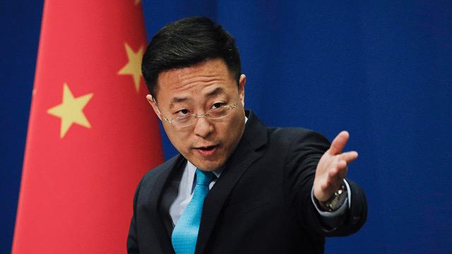"""中国外交部发言人赵立坚甩锅""""美军说""""惹争议。(美联社资料图片)"""