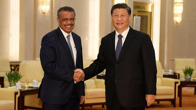 中国领导人习近平2020年1月28日在北京会见世界卫生组织总干事谭德塞(左)(路透社)
