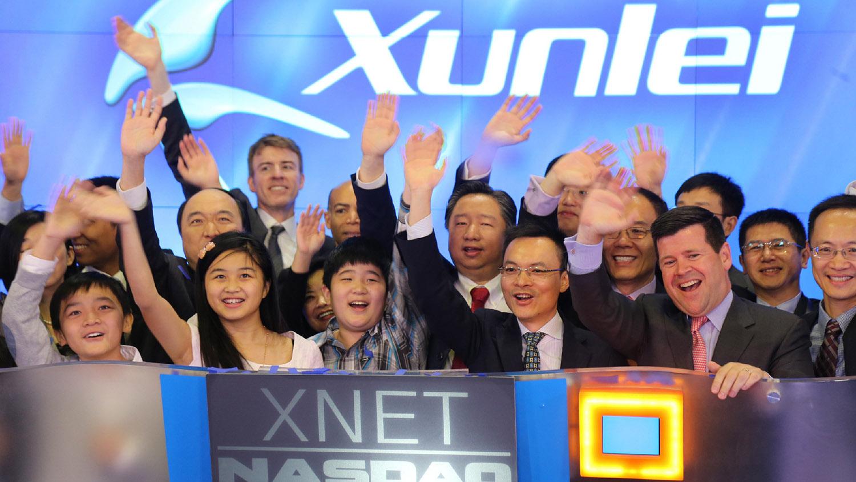 中国公司迅雷庆祝在纳斯达克上市成功。(美联社)