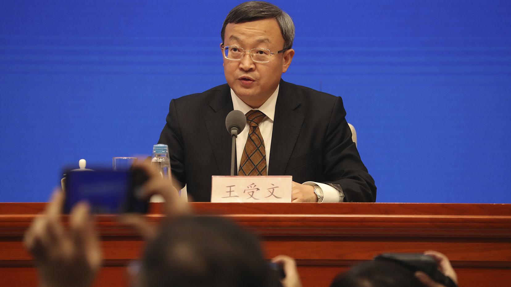 商务部副部长王守文在记者会上。(美联社)