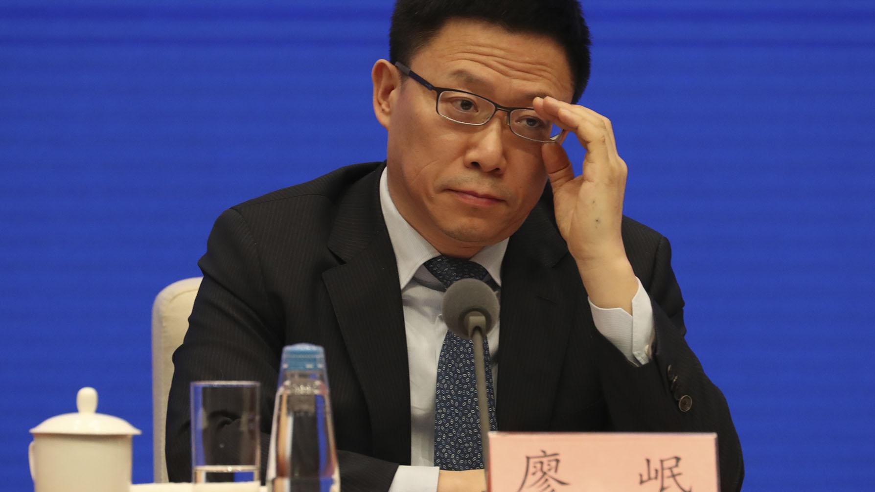 财政部副部长廖岷在记者会上。(美联社)
