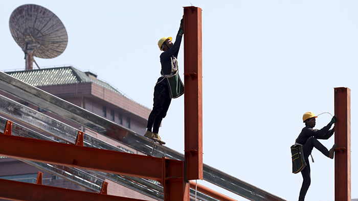 在北京建筑工地上工作的农民工大多不具有高中学历(美联社)