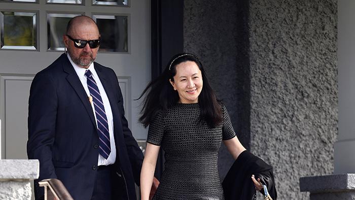 2019年5月8日,中国华为公司高管孟晚舟离开她在加拿大温哥华的住所前往当地法庭。(路透社)