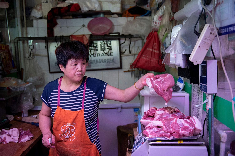 受到非洲猪瘟及美中贸易战影响,中国生猪价格进一步上涨。(资料图/法新社)