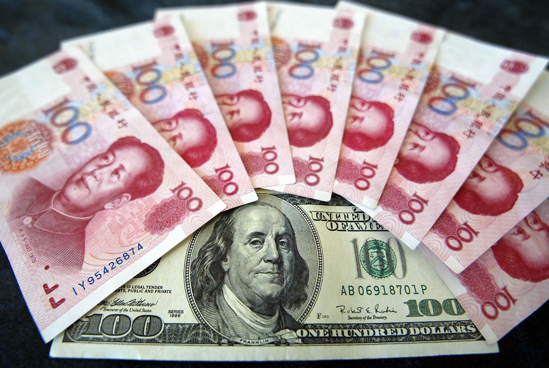 今年8月初,美元兑人民币汇率突破了历史性的7大关(1美元兑7元人民币)。(法新社)