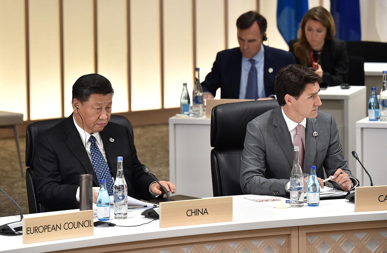 2019年6月29日,加拿大总理特鲁多(右)和中国国家主席习近平在日本大阪出席G20峰会。(路透社)