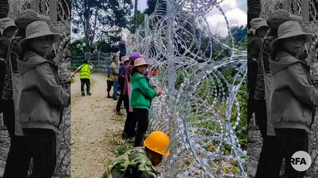 中越边界隔离网将通高压电     越南警方派边民拆网