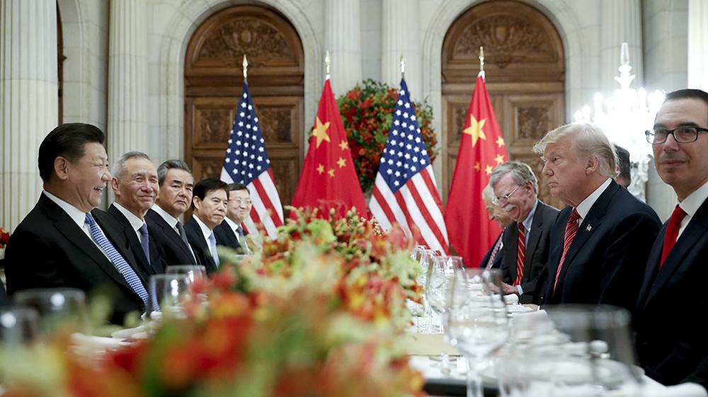资料图片:2018年12月1日,中国领导人习近平与美国总统特朗普在阿根廷会面。(美联社)
