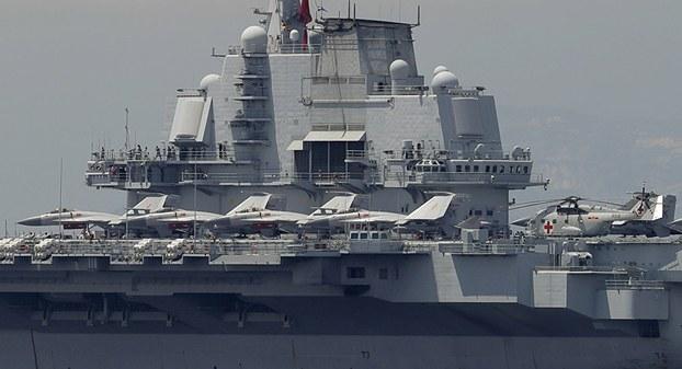 中国已开始研制第三艘国产航母,目前该新型航母已经在船台上有序建造。(美联社)