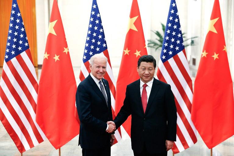 图片:2013年12月4日,中国国家主席习近平在人民大会堂会见美国副总统拜登。(法新社)