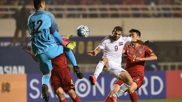 资料图片:中国国家足球队在2019年与叙利亚队的比赛中失利(法新社)