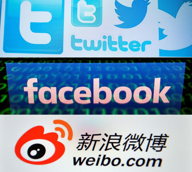 中国青年严正抗议推特脸书被封锁,却不提国内微信群大量被封 。(资料图/法新社)