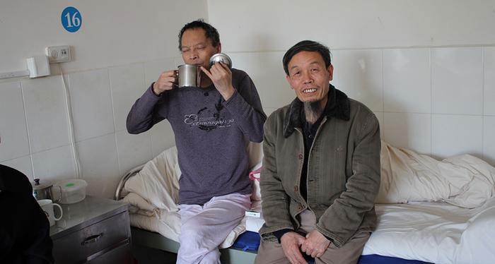 资料图片:朱承志在李旺阳(左)生前多次探望。(推特图片)