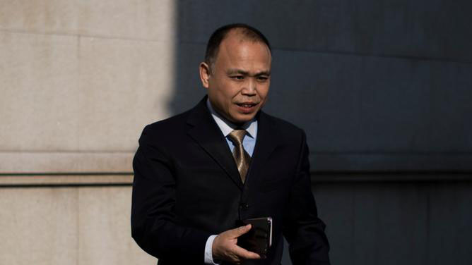 """被控""""煽动颠复国家政权罪""""的律师余文生,已被关押近两年。(资料图/法新社)"""