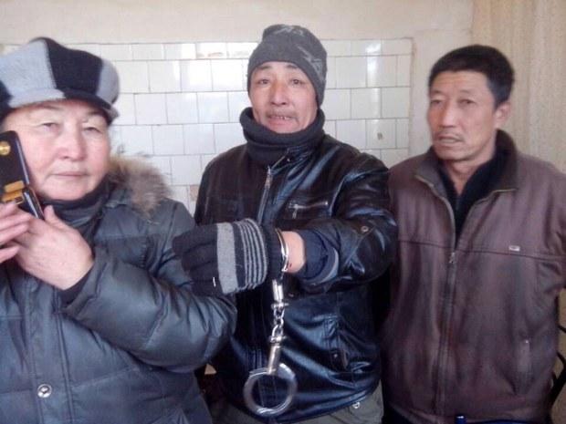Jargal_handcuffed.JPG