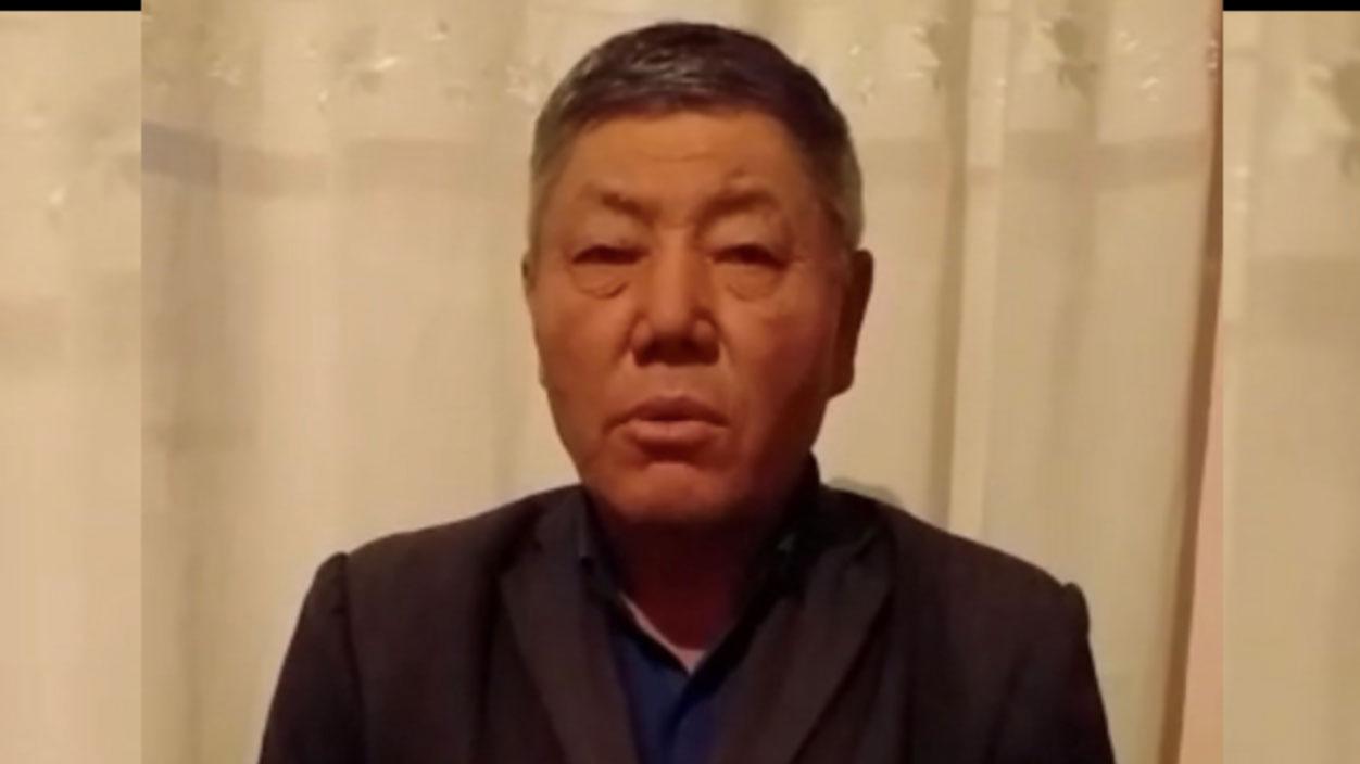 哈萨克族努尔兰被囚禁在笼子里。(视频截图)