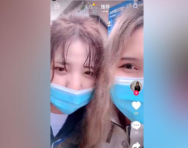 两位维吾尔族女子讲述在广州入住酒店被拒。(推特视频截图)