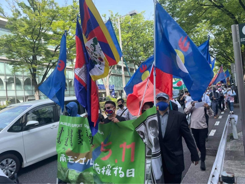 遊行示威人士來自日本各地,600人的遊行隊伍在東京繁華地區沿街高呼口號。(志願者提供/記者喬龍)