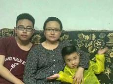 仰华的妻子和两个孩子.jpg