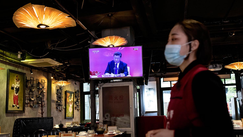 """疫情过后,北京提出以""""国民经济循环为主构建新发展格局""""。习近平在庆祝大会上强调,目前世界经济面临复杂挑战,需要全面扩大开放,但新发展格局并非封闭国内循环。(法新社图片)"""