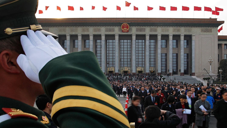 有舆论认为,中国共产党作为一个执政党,倘若把对党员的要求扩大到国家公务员,甚至普通民众,通过全国人大立法,最终成为全国性法规,很不妥当。(资料图/美联社)