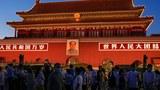资料图片:2021 年 6 月 3 日,游客在北京天安门前参观。