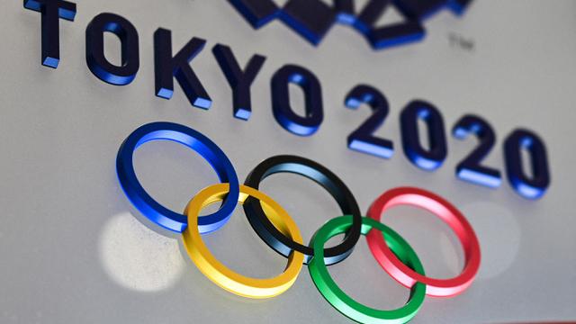东京奥运因疫情延后一年,菅义伟决定今夏举办一场无观众的奥运,并将邀请拜登出席。(法新社)