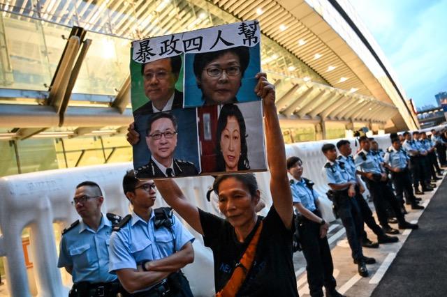 北京把自己在香港问题上绑死了,送中条例引发的危机证明北京挫败,既失了面子,也失去里子。(法新社)