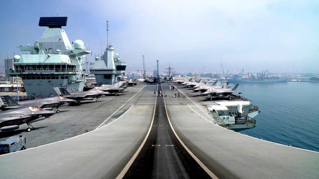 英国国防大臣华莱士表示,英国伊丽莎白女王号航母打击群9月访问日本之后,英国将永久性部署两艘军舰在印太海域。(法新社)