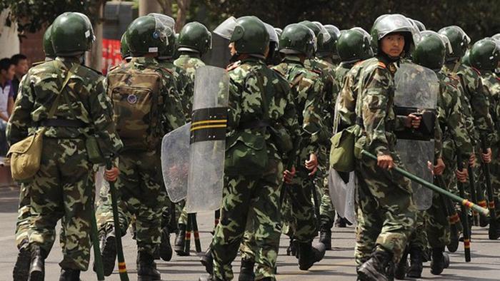 """新疆""""七五""""事件后,当局全面加强对少数民族的管控。(资料图/AFP)"""