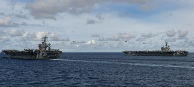 台湾一旦失守,中共下一个目标是南海。图为2020年7月美国尼米兹号与里根号航母在南海演训。(美国第七舰队)