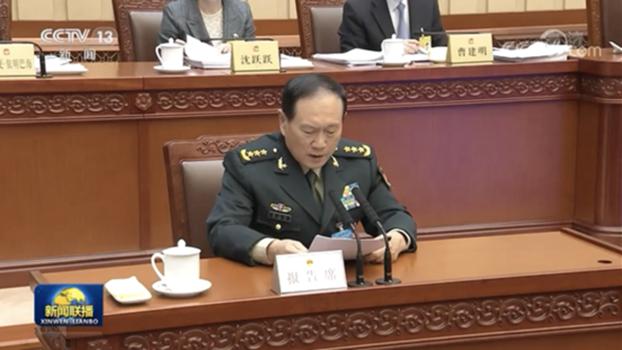 中国国防部长魏凤和做《国防法》修订草案报告。(视频截图)