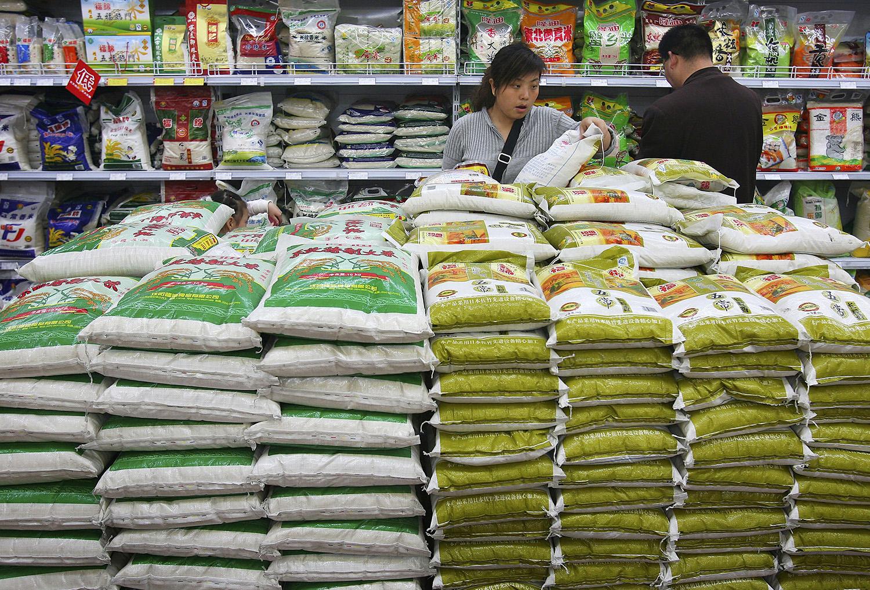 中国是大米王国,转基因大米的健康疑虑,备受消费者关注。(美聯社)
