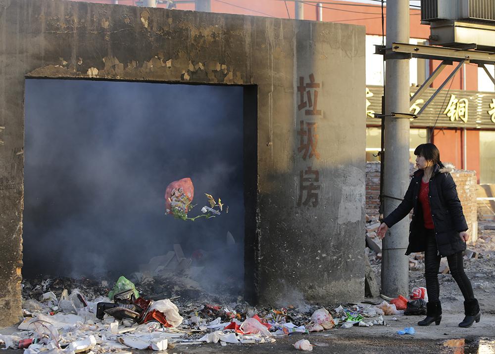 中国是全球最大的焚烧炉市场,污染问题层出不穷。(法新社)
