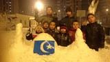 musapir-uyghur-bala-qar-oyun.jpg