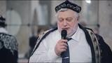 Dimitriy wasilyéfke moskwada ötküzülgen Uyghurshunasliq yighinida ton kiydürülmekte. 2016-Yili 10-ay. Moskwa.