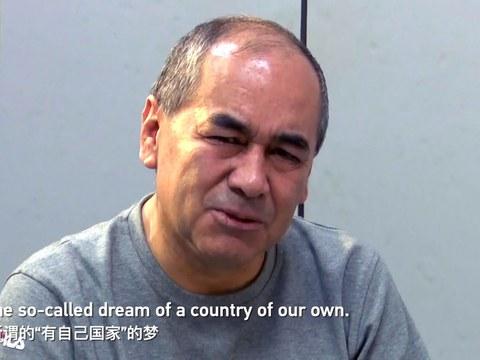 Uyghur aptonom rayonluq siyasiy qanun komitétining sabiq mu'awin sékrétari shirzat bawudun sin körünüshide iqrar qilduruluwatqan körünüsh. 2021-Yili aprél.