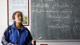 Xotendiki-melum-ottura-mektep-Uyghur-oqutquchisi-derste-305