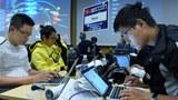 Đội tuyển Việt Nam đang thi đấu kỹ năng hacking tại vòng chung kết cuộc thi an ninh máy tính SECCON 2015 tại Tokyo vào ngày 31/1/2016.
