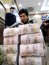 Tiền polymer. AFP photo