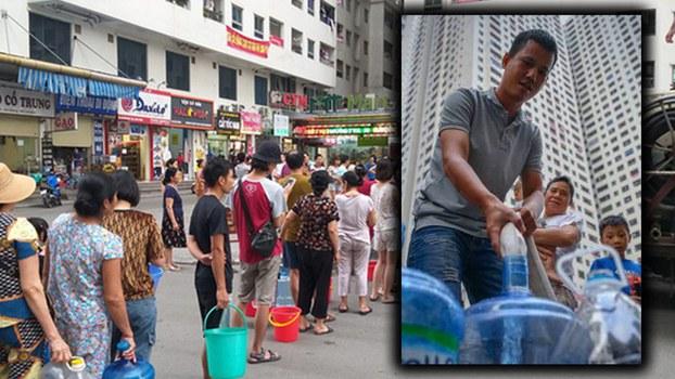 Người dân Hà Nội xếp hàng lấy nước sạch