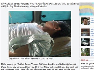 Hình ông Trần Văn Thanh được đưa đến tòa trên băng ca được đăng tải trên trang web của vnexpress.(Tướng công an Trần Văn Thanh nằm bệnh viện còn thở oxy vẫn bị khiêng ra tòa.)