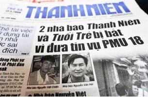 Hai nhà báo Nguyễn Việt Chiến và Nguyễn Văn Hải bị bắt vì đưa tin vụ PMU 18. AFP