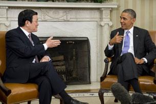 Tổng thống Hoa Kỳ Barak Obama tiếp Chủ tịch Trương Tấn Sang tại Nhà Trắng hôm 25/07/2013.