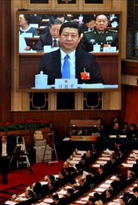 Phó Chủ tịch Trung Quốc Tập Cận Bình xuất hiện trên màn hình trong thời gian Quốc hội Trung Quốc nhóm họp tại Đại lễ đường Nhân dân ở Bắc Kinh vào ngày 05 tháng 3 năm 2012. AFP PHOTO.