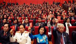 Các đại biểu của Đại hội Đảng Cộng sản Việt Nam lần thứ 11 trong phiên họp bế mạc tại Hà Nội ngày 19 tháng 1 năm 2011. AFP PHOTO.
