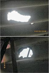 Mái nhà ông Huỳnh Ngọc Tuấn bị thủng nhiều lỗ rất to. Files photos