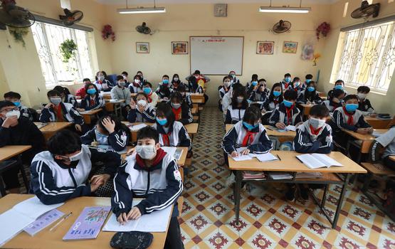 Hình minh họa. Học sinh đeo khẩu trang trong lớp ở trường cấp 2 Định Công, Hà Nội hôm 31/1/2020